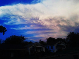I travel under a stormy sky