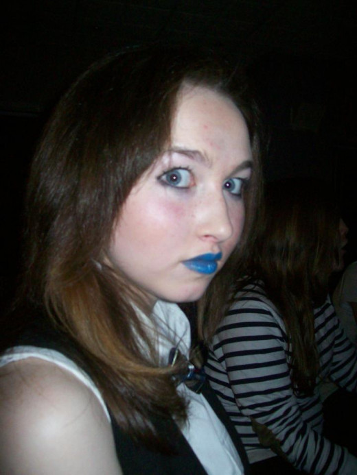 Blue lipstick and bow tie.