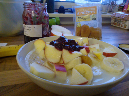 Porridge with apple, banana, dried apricots and home made raspberry jam