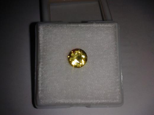 1ct Yellow colour change Sapphire