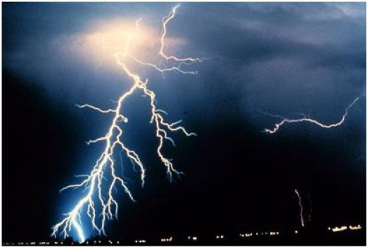 Cloud to Ground lightning makes a series of steps downward before meeting with a heat channel coming up from the earth.
