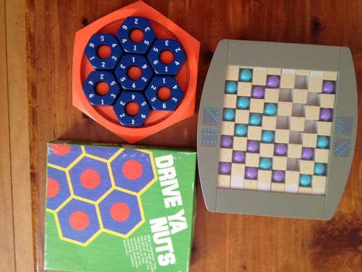 To your left:  Drive Ya Nuts by Milton Bradley  and To your right:  SwitchBack by Binary Fames
