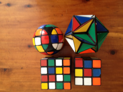 A Rubik ball, a star, and two sizes of the cube