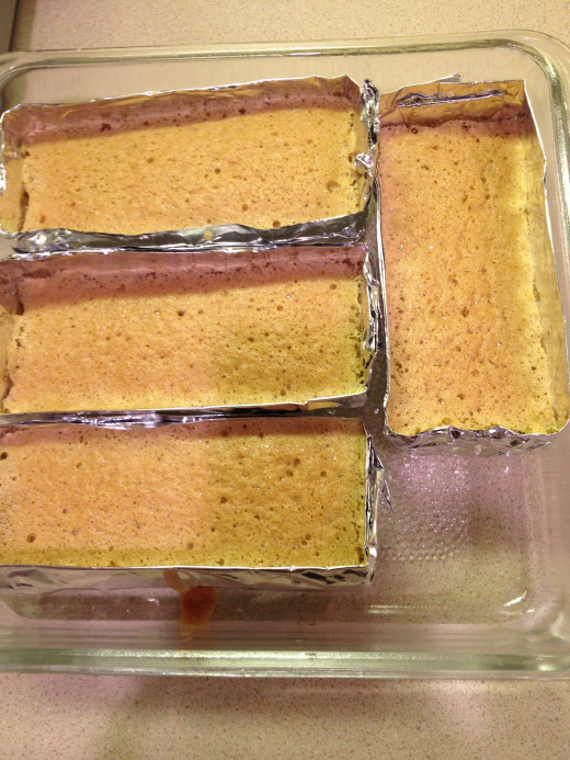 Place the cakes in a square baking pan to prevent movement  while baking.