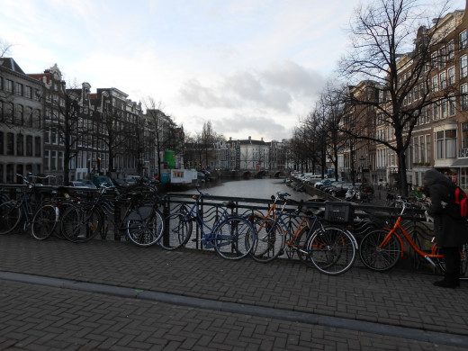 Bikes are everywhere in Amsterdam. Here's a familiar sight of bikes being parked along a canal bridge.
