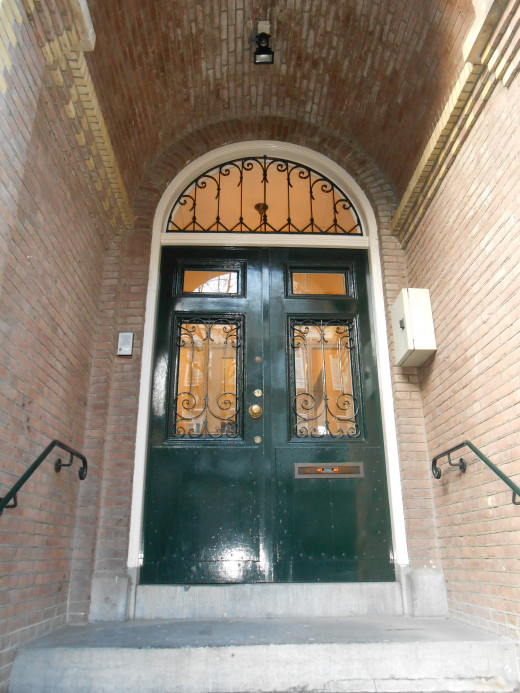 A typical doorway in Amsterdam with an overhang to keep out of the weather.