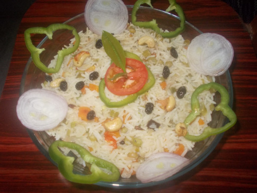 Decorate the prepared Biryani as you like.