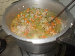 Transfer the vegetable into half cooked rice.