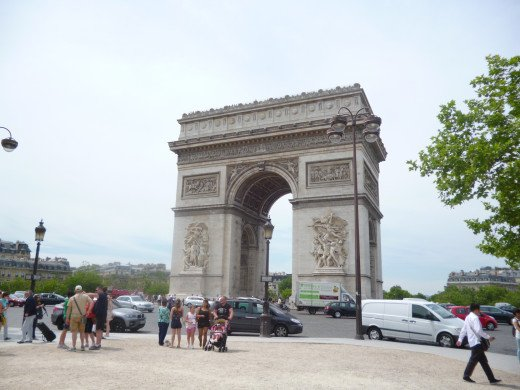 The Arc du Triomphe dominates the middle of a busy roundabout