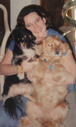 Me many years ago, with Lady (black) and Corky (gold).