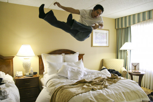 Your host may not enjoy your version of enjoying the bed he provides you for the night.  Be a considerate house guest.