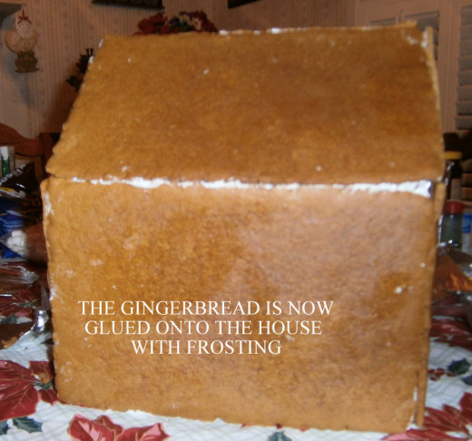The pieces of gingerbread are now attached to the house.