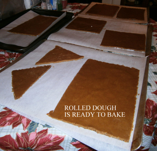 Cut out pieces of gingerbread are now ready to bake.