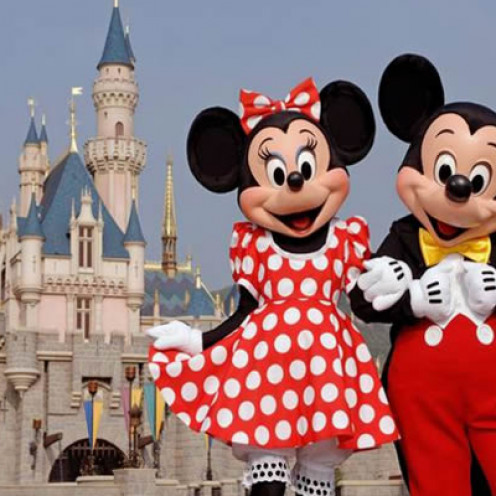 Mickey and Minnie Mouse welcoming their guests to Disneyland
