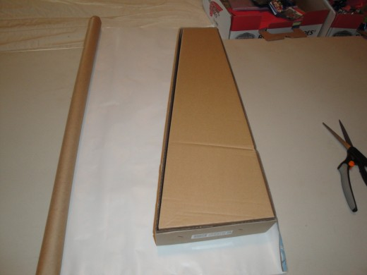 For oddly shaped packages; tape first edge, then roll package over so it lays on top of paper.