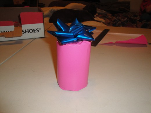 Add a bow, or streamers of curling ribbon to the top, and a name tag and your done!