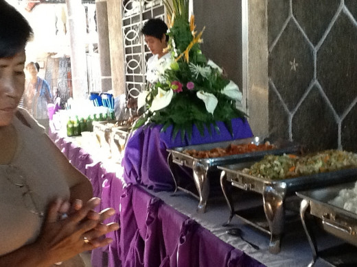 Food caterer setting the food to be served