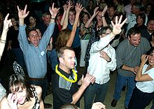 Crowd showing enthusiasm for a band in Colorado