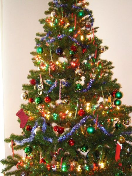 Christmas tree featuring many colored baubles.