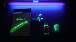 Photoluminsecence, like highliters and glow-in-the dark paint are one of the forms of natural luminescence.