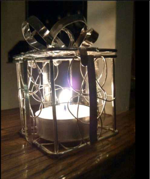 Candlelight brightens the room, where hope is reborn for peace and goodwill to men. ~