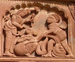 A scene from the epic Mahabharata ( Duhsashana, the Kaurava brother tryuing to strip Draupadi, the wife of the Pandava brothers while Lord Krishna supplying endless dress material to Draupadi by His divine power)
