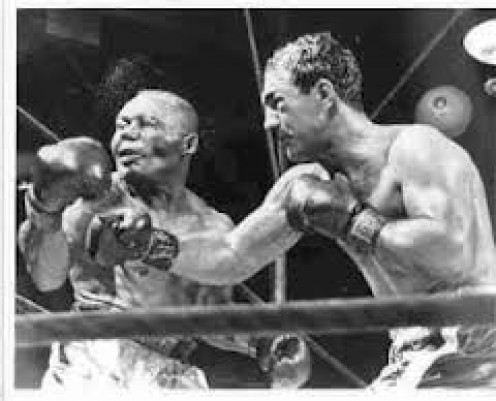 Rocky Marciano knocks out Jersey Joe Walcott in the 13th round to claim the heavyweight championship. In the rematch he knocked Walcott on in one short brutal round.