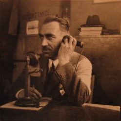 A Man Using an Early Telephone