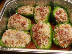 Cleaned raw peppers stuffed with meat mixture.