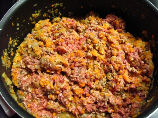Add the ground meat, stirring well and braking any meat lumps,