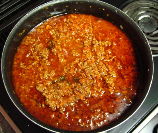 Once it starts boiling, lower the stove temperature and let it simmer, stirring every now and then, for about 60 minutes.