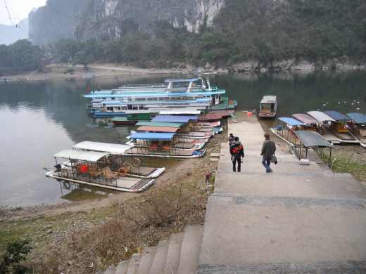 Your hostel can help you make arrangements for traveling down the river to Yangshuo.
