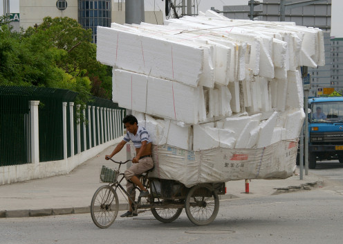 A man with a heavy load in Shanghai.