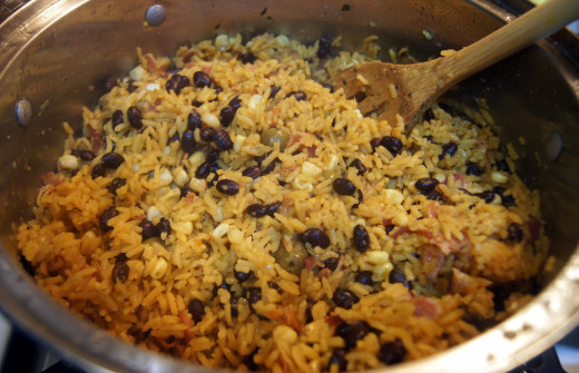 Turn rice over (one section at a time). By now everyone in the house will be drooling because of all the great aromas in the house! Serve and Enjoy!!