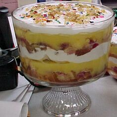 Your finished trifle should look like this.  Layers of pound cake, pudding, fruit, jelly and whipped cream.  This example shows whipped cream between the layers of the trifle.  In my version, I only put whipped cream on top.  Yum!