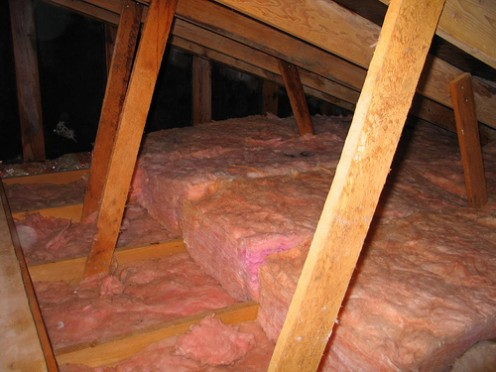 Adding insulation between the floor joists to achieve a higher R-Value.