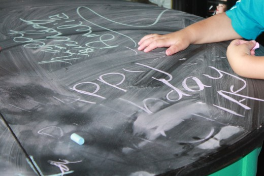 A chalkboard table is the perfect addition to an arts and craft themes birthday party.