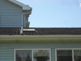 Curling roof shingles indicate that the shingles need to be replaced.