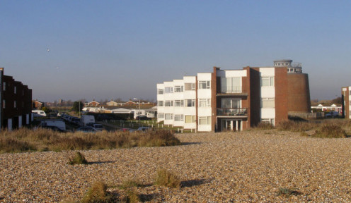 Timberlaine Road from the beach, Pevensey Bay. Martello Tower 61 is on the right of the view.