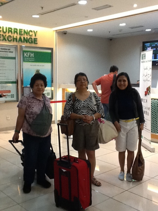 The girls :Maureen,Tina and Emy at the currency exchange booth at Kuala Lumpur International Airport.