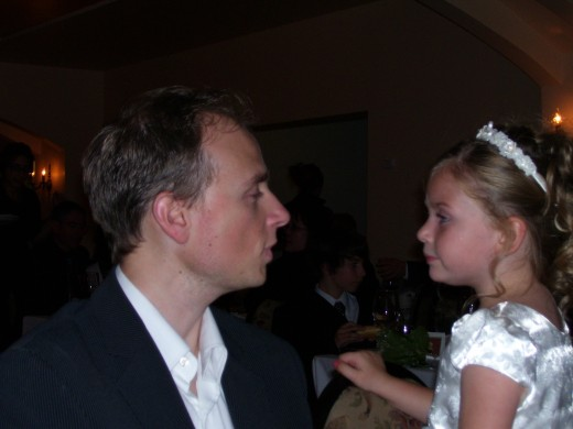 A special moment captured in 2008 between a father and daughter at a wedding reception for a friend