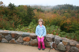 Autumn ~ Our daughter sitting on a wall along the Kankamangis Scenic Highway in NH
