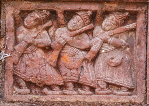 Three men with musket; terracotta; Maluti
