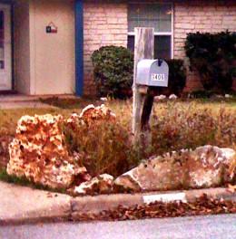 Stones surround a mailbox