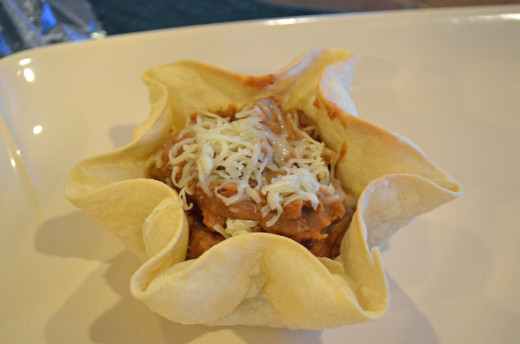 Homemade bean dip is a great addition to a tortilla shell bowl for a party or get-together.