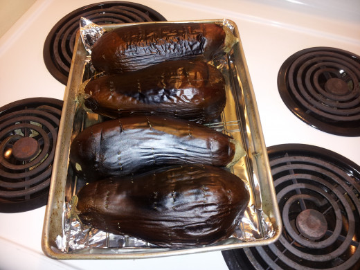 Turn the aubergines 90 degrees, four times