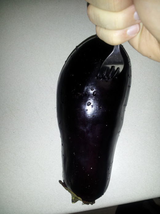 Stabb the eggplant with a fork.