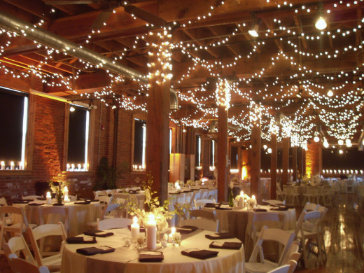 Add lights and sparkly elements to matte tablecloths for a wedding that truly shines!