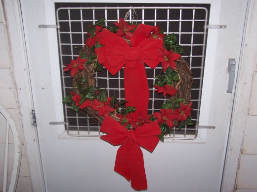 a wreath of the holiday spirit to greet all who enter
