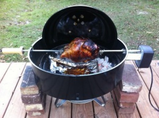 The Weber Jumbo Joe is very versatile.  Open air rotisserie cooking is a lot of fun!